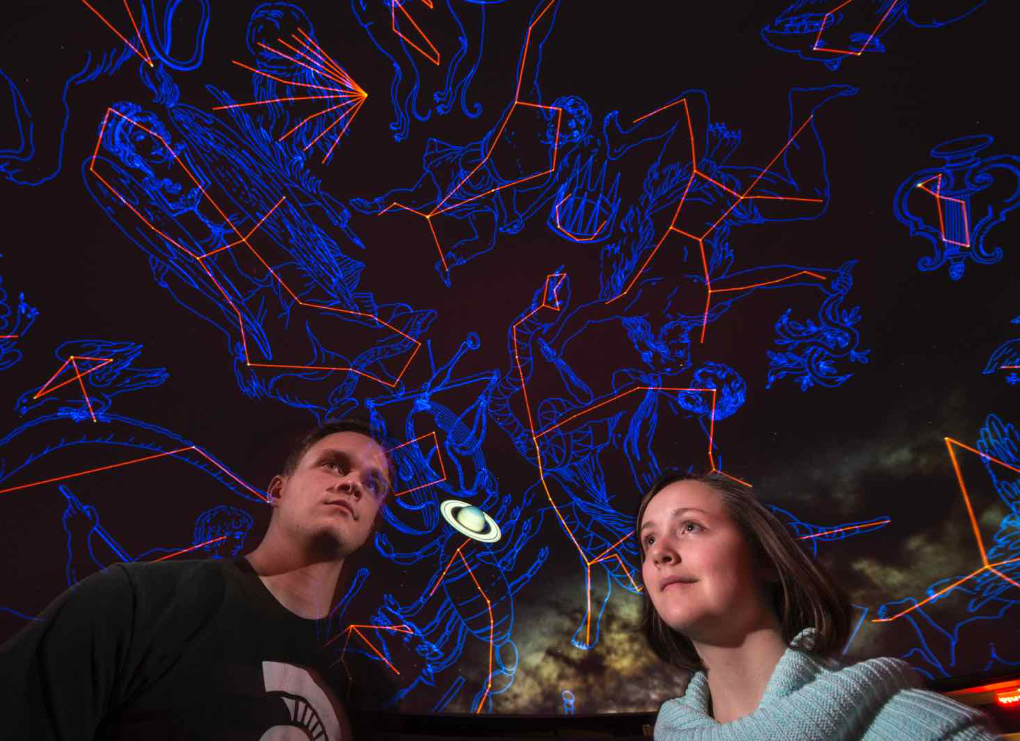 People gaze at constellations on the ceiling of the planetarium